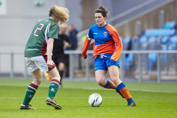 Emily competing at the Manchester City Football Academy stadium with our women's football team last year.